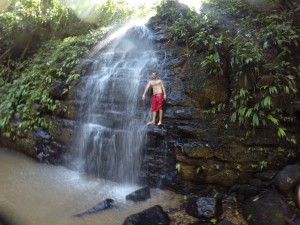 Trey at the 50 ft Goddess waterfall at the beginning of the dry season