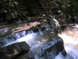 "Ngoc enjoying one of the cascading waterfalls from the ""Goddess"" 50ft horsetail waterfall."